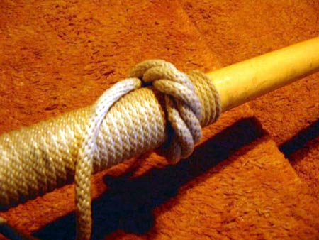 Here's a picture of the rope wrapping on one of my light oars. In the photo  below, I attached a commercial rubber Button that is force fitted over the  wraps ...